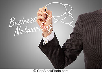 business networking - businessman hand writing 'business...
