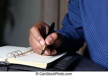Businessman hand writing with pen on paper