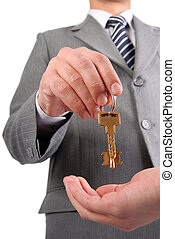 Businessman handing a key