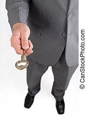 Businessman handing a success key