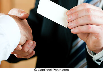 Businessman handing over business card