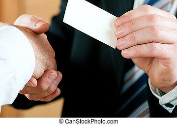 Businessman handing over business card