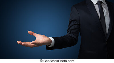 Businessman handing something without concept
