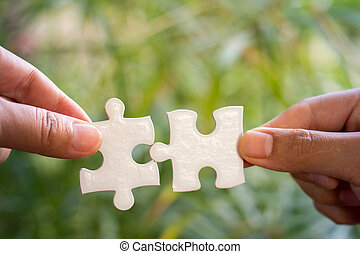 Businessman hands connecting jigsaw puzzle. Business solutions, success and strategy, learning concept.