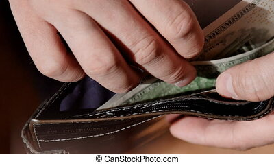 Businessman hands counting dollar bills in his wallet. UltraHD video