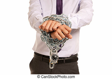 Businessman hands fettered with chain and padlock, job slave...