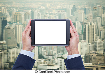 Close up of a person holding blank screen digital tablet on stock businessman hands holding blank screen digital tablet on cityscape background malvernweather Choice Image
