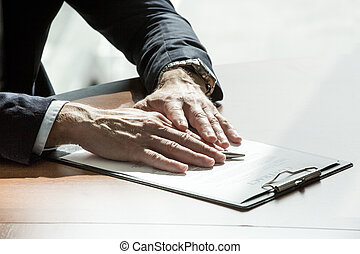 Businessman hands on contract