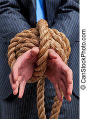 Businessman hands tied
