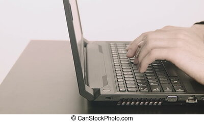 Businessman hands typing