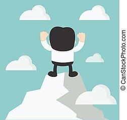 Businessman hands up on hilltop with joy