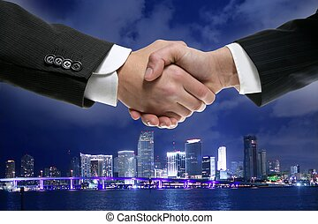 Businessman handshake in Miamy downtown night