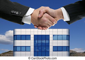 Businessman handshake over mirror building