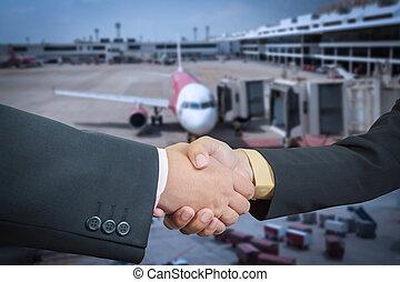 Businessman handshake with air plane transportation logistic...
