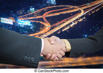Businessman handshake with power or energy transportation logistic background