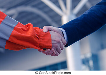 businessman handshaking with worker