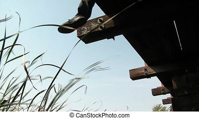 Businessman Hanging on the Edge - Unique clip shot under...