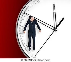 Businessman hangs on an arrow of clock, isolated on red...