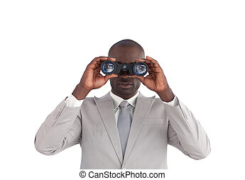 Businessman happy Looking through binoculars