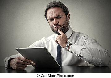 Businessman hardly thinking