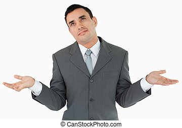 Businessman has no clue against a white background