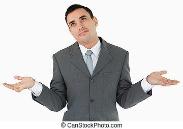 Businessman has no clue against a white background