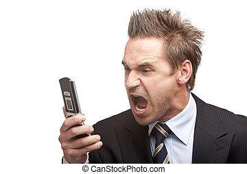 Closeup of stressed businessman holding a mobile phone and screams into it. Isolated on white background