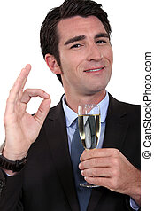 Businessman having a glass of champagne