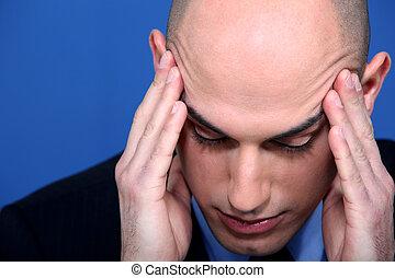 businessman having a head ache