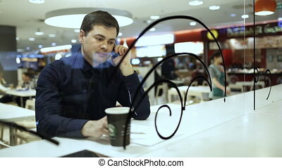 Businessman having a phone talk in cafe