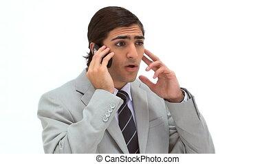 Businessman having a serious talk on the phone