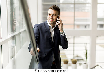 Businessman having phone call in the office