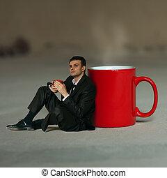 Businessman having tea