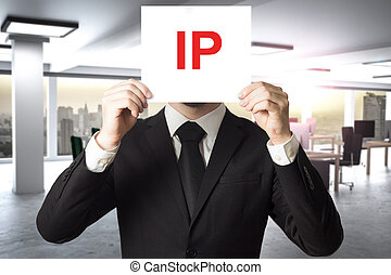 businessman hiding face behind sign ip