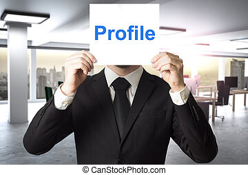 businessman hiding face behind sign profile