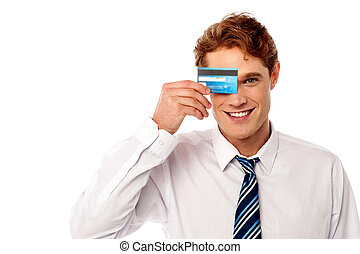 Businessman hiding his eye with credit card - Young male ...