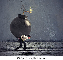 Businessman hold a bomb. Concept of difficult career and failure