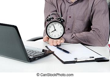alarm clock - Businessman holding a alarm clock. Isolated on...