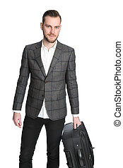 Businessman holding a bag - A handsome businessman holding a...