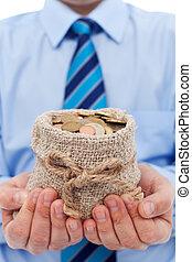 Businessman holding a bag of euro coins
