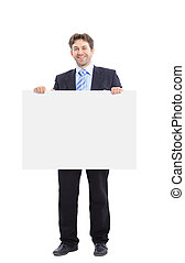 Businessman holding a banner ad isolated on white