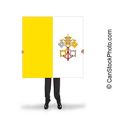 Businessman holding a big card, flag of Vatican City