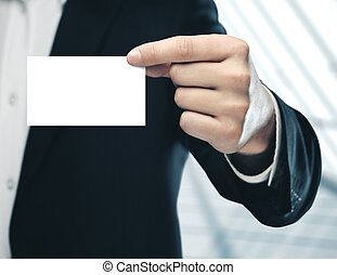 Businessman holding a blank business card.