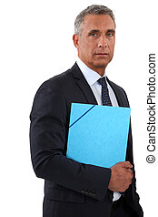 Businessman holding a blue folder