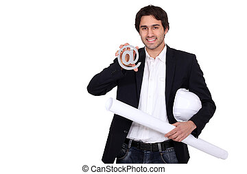 businessman holding a blueprint and an at sign