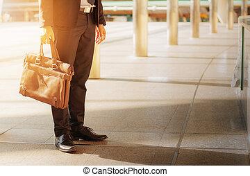 Businessman holding a briefcase.