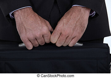 businessman holding a briefcase