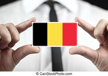 Businessman holding a business card with a Belgium Flag