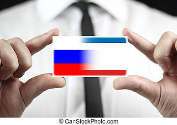 Businessman holding a business card with Autonomous Republic of Crimea and Russia Flag