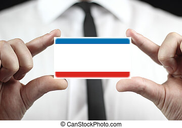 Businessman holding a business card with Autonomous Republic of Crimea Flag